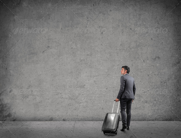 Businessman with Luggage - Stock Photo - Images