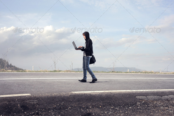 Walking with the Laptop - Stock Photo - Images