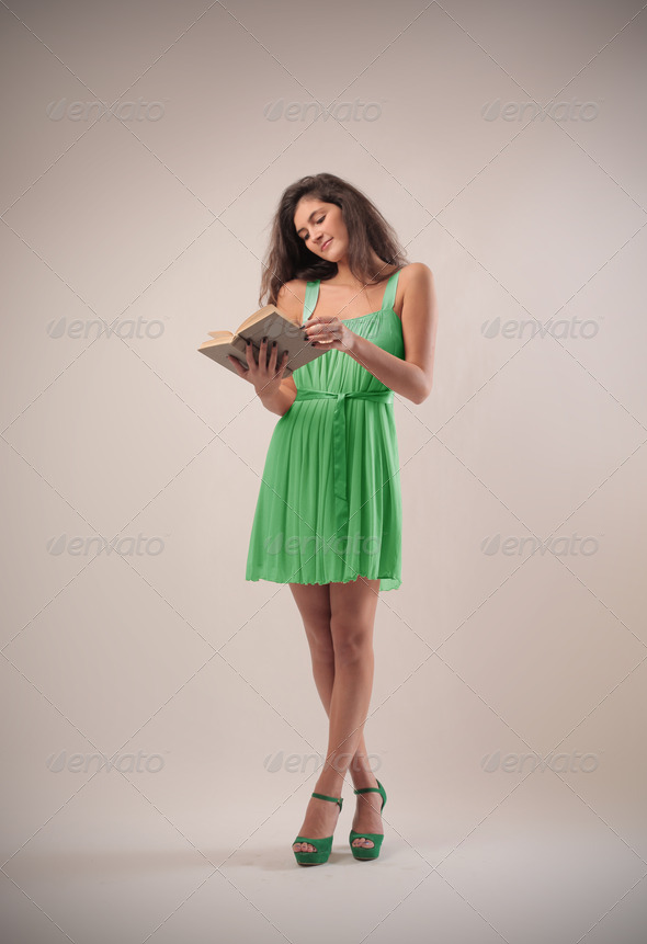 Reading Girl in Green - Stock Photo - Images