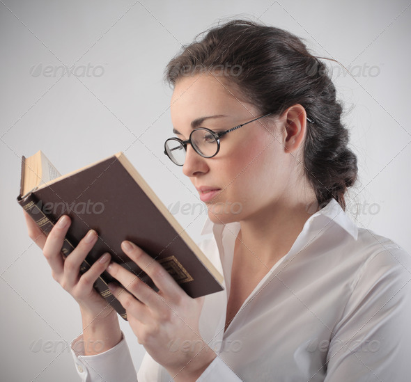 Reading a Book - Stock Photo - Images