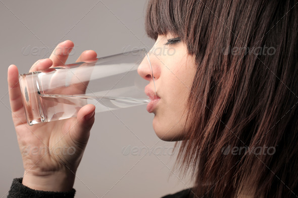Drinking a Glass of Water - Stock Photo - Images