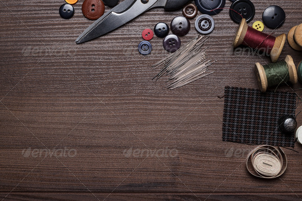 Needles Threads And Buttons  On Brown Wooden Table - Stock Photo - Images
