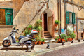 Motorcycle on cobbled street in Ventimiglia, Italy. - PhotoDune Item for Sale