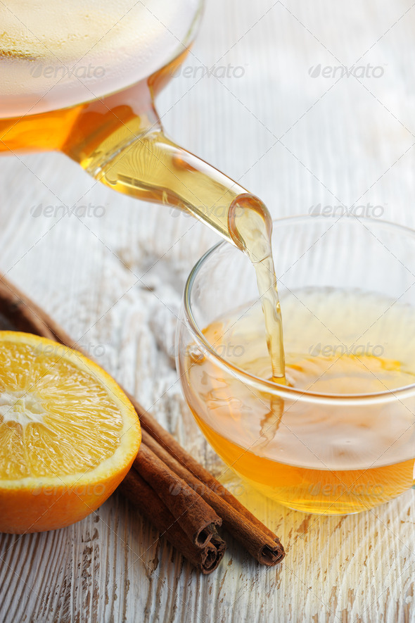 Pouring Tea into Glass Cup - Stock Photo - Images
