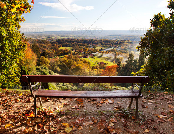 Bench in a park with views of the countryside. - Stock Photo - Images