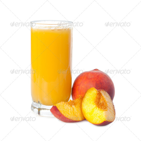A glass of peach juice with fruits - Stock Photo - Images