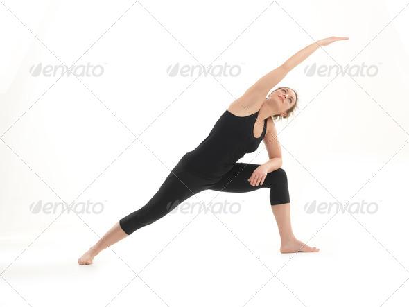 stretching yoga pose demonstration - Stock Photo - Images