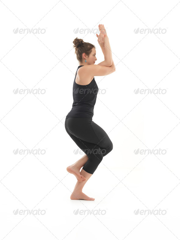 yoga practitioner demonstrating balance yoga posture - Stock Photo - Images