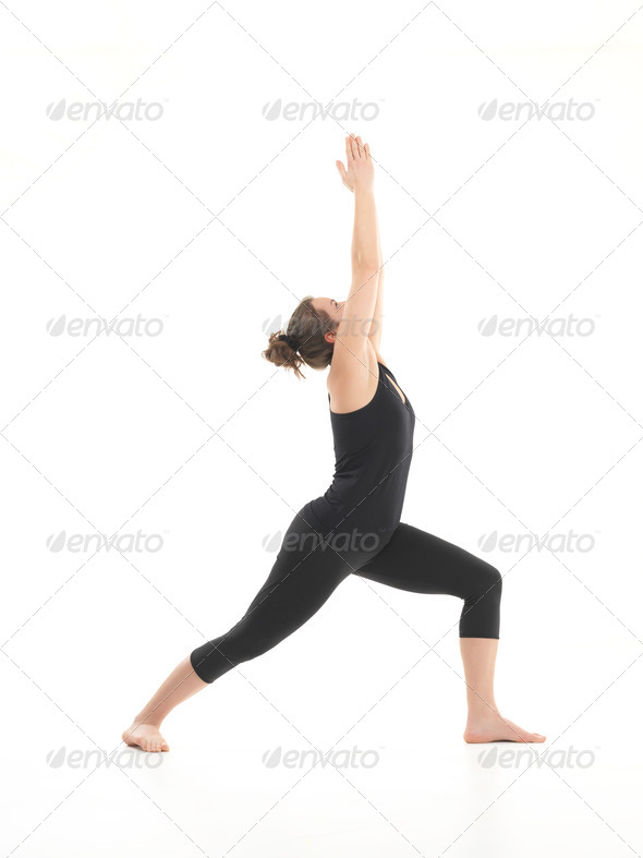 demonstration of stretching yoga posture - Stock Photo - Images