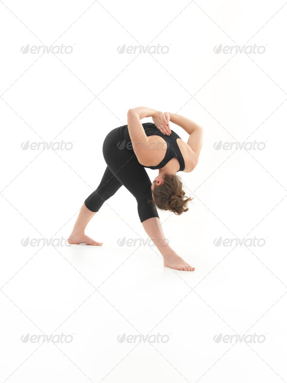 demonstration of contorting yoga posture - Stock Photo - Images