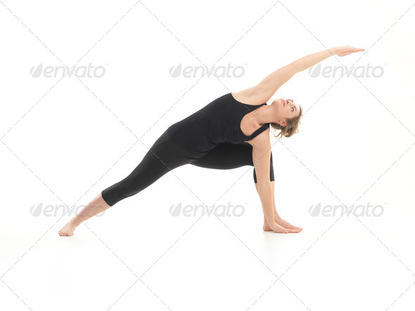 demonstration of advanced yoga pose by young attractive woman - Stock Photo - Images