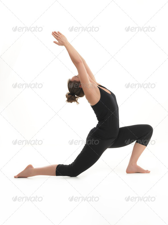stretching yoga pose demonstration - Stock Photo - Images