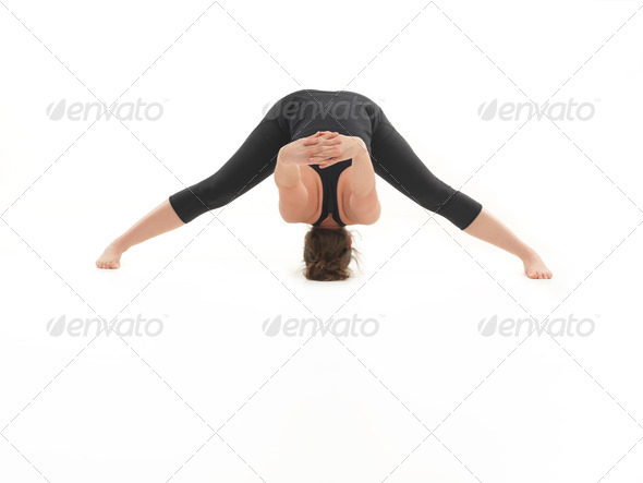 demonstration of difficult stretching yoga pose - Stock Photo - Images