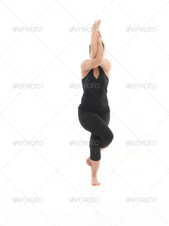 balance yoga pose demonstration - Stock Photo - Images