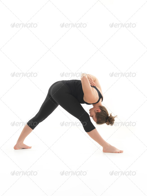 yoga posture demonstration by young female instructor - Stock Photo - Images
