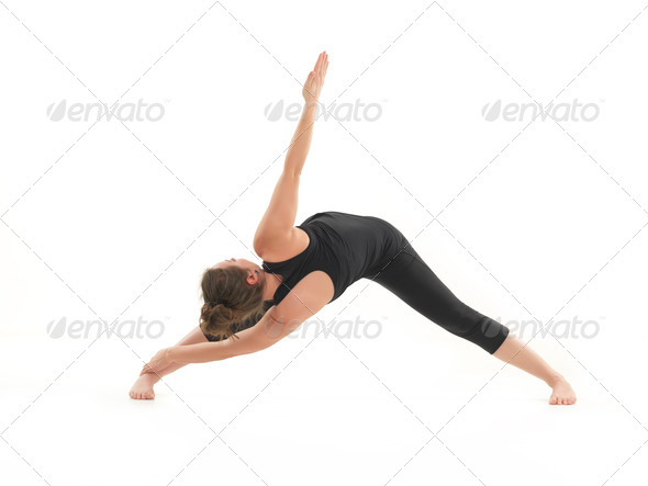 balance and stretching yoga pose demonstration - Stock Photo - Images