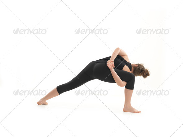 young blonde woman in yoga pose - Stock Photo - Images