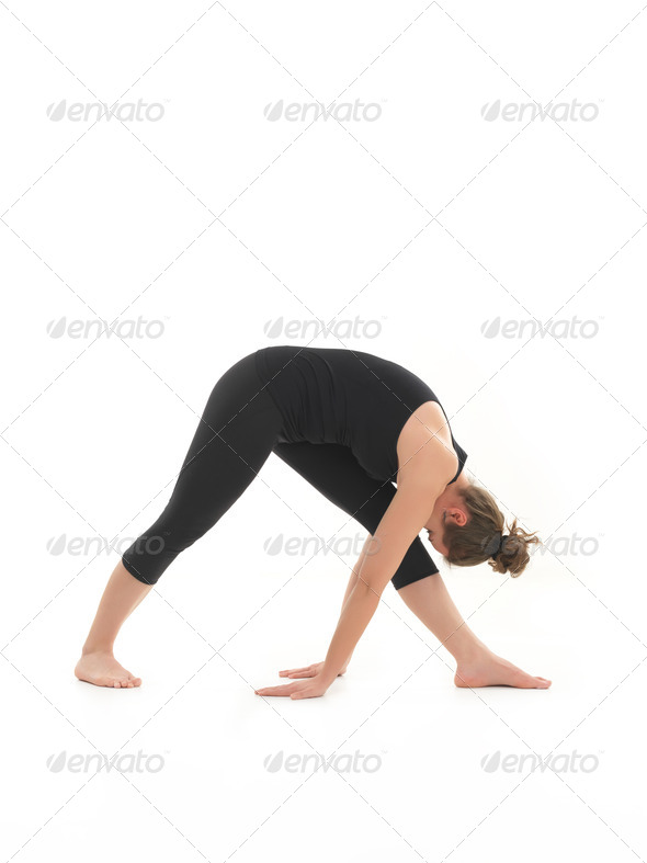 young woman demonstrating begginer yoga pose - Stock Photo - Images