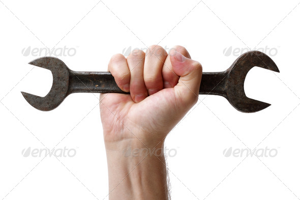 Wrench in hand - Stock Photo - Images