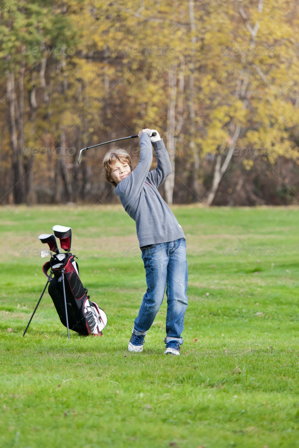 Young golfer swing - Stock Photo - Images