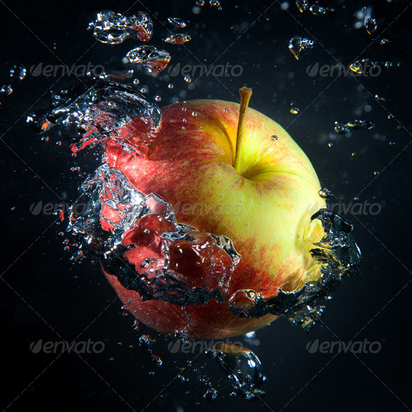 Apple is under water in a stream of air bubbles - Stock Photo - Images