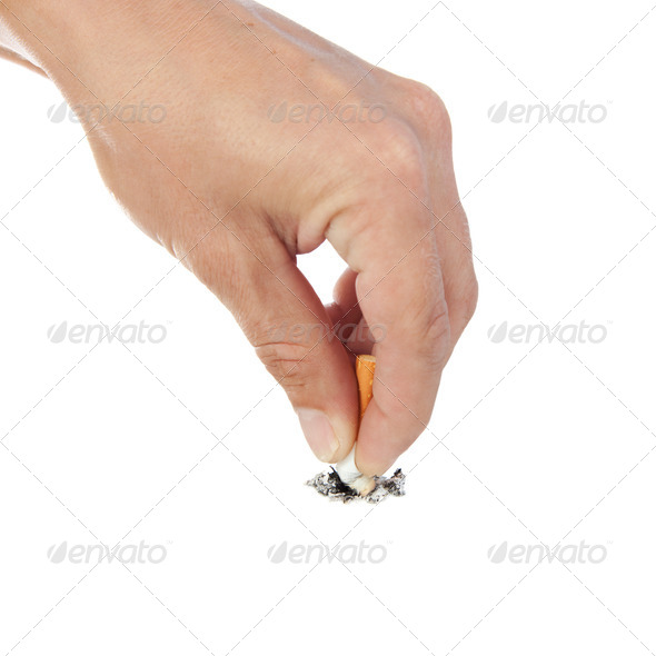 Hand extinguishes his cigarette. - Stock Photo - Images