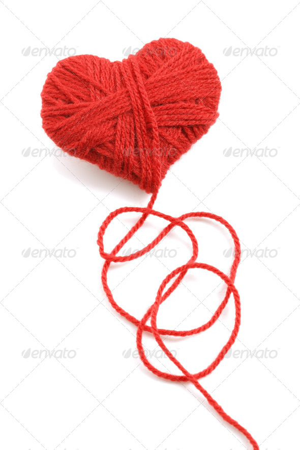 Yarn of wool in heart shape symbol - Stock Photo - Images