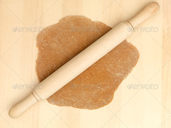 gingerbread dough rolling pin - Stock Photo - Images