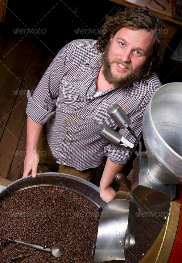 Master Roaster Monitors Coffee Bean Roasting - Stock Photo - Images
