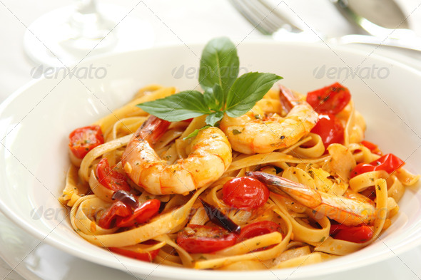 Fettuccine with prawn in tomato sauce - Stock Photo - Images