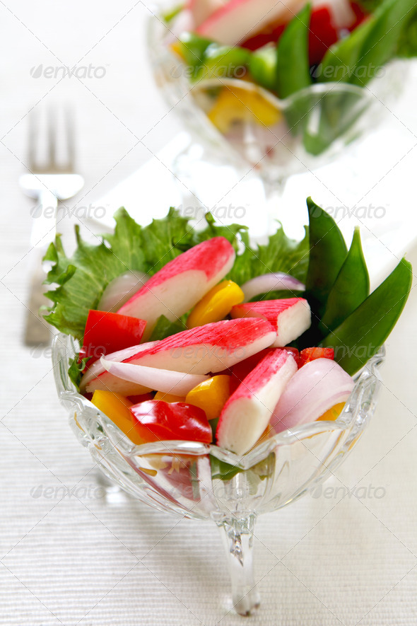Crab stick with pepper and lettuce salad - Stock Photo - Images