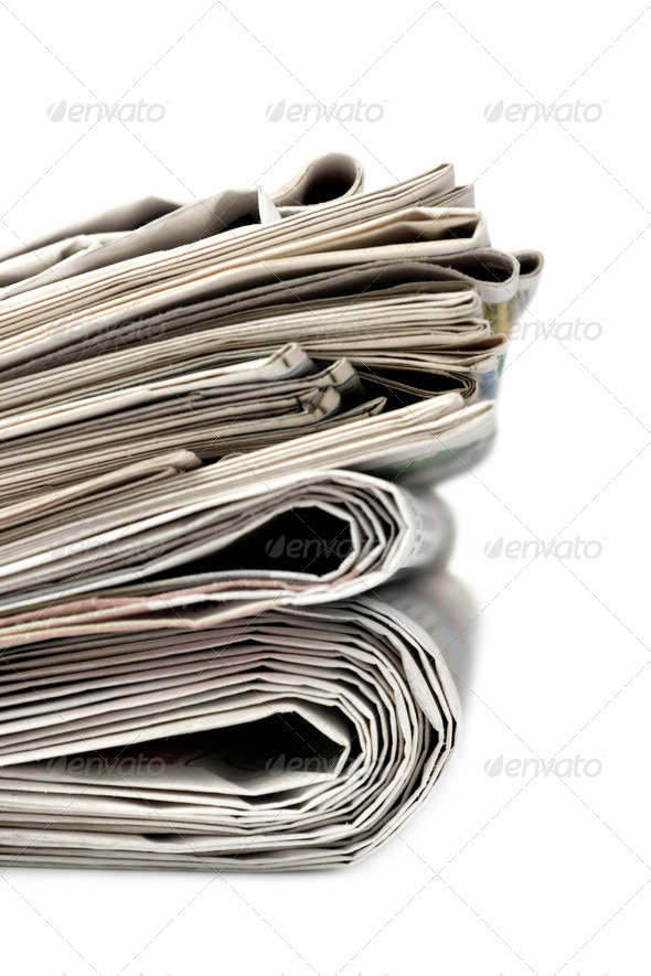 A stack of newspapers. - Stock Photo - Images