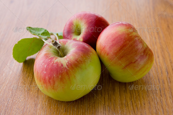 Juicy apples with leaves - Stock Photo - Images