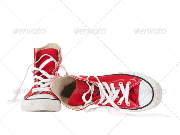 Vintage red sneakers fallen on the ground on white background - Stock Photo - Images