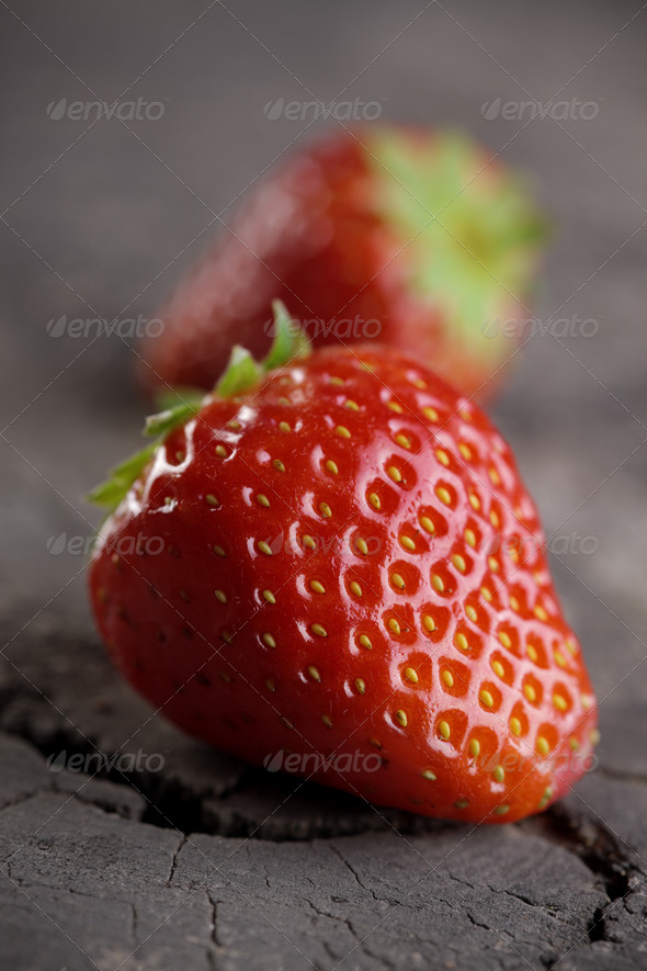 Fresh strawberries on old wooden background - Stock Photo - Images