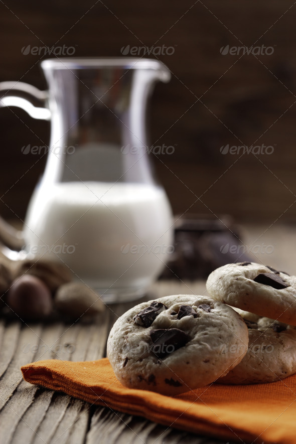 Chocolate chip cookies with ingredients in the background - Stock Photo - Images