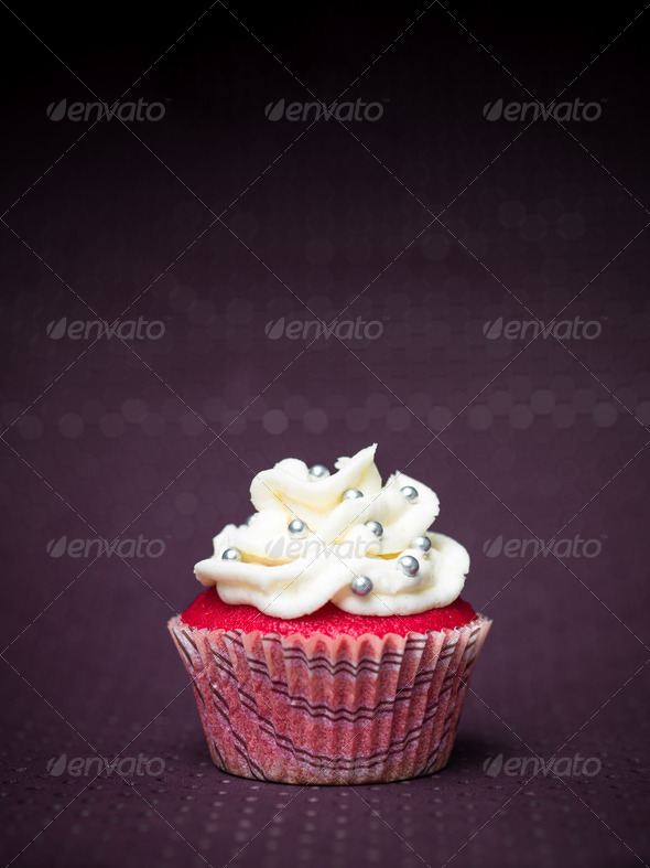 red cupcake purple background - Stock Photo - Images