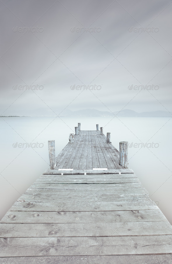 Wooden pier on lake in a cloudy and foggy mood. - Stock Photo - Images
