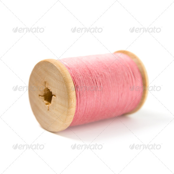 The wooden spool with pink thread - Stock Photo - Images