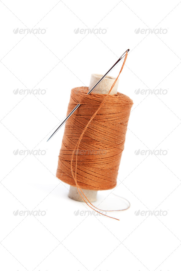 Spool of thread with a needle - Stock Photo - Images