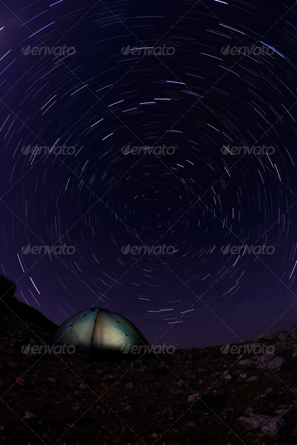 Tourist tent in the night sky - Stock Photo - Images