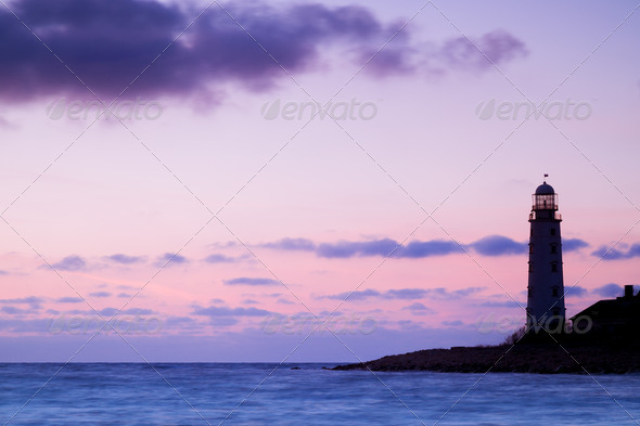 Seascape and the lighthouse on the coast - Stock Photo - Images