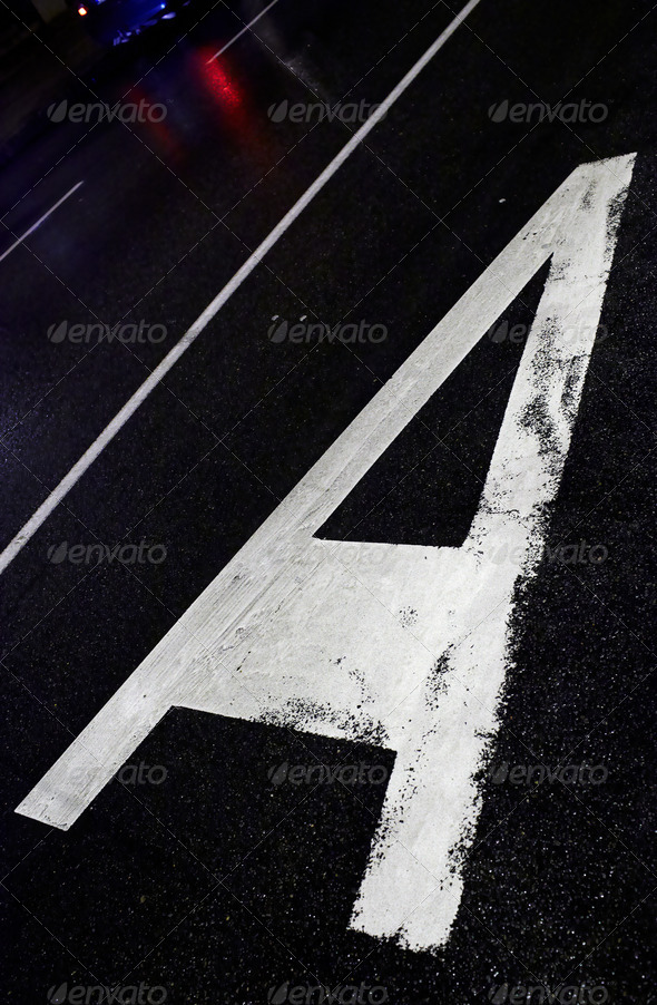 Sign on asphalt - Stock Photo - Images