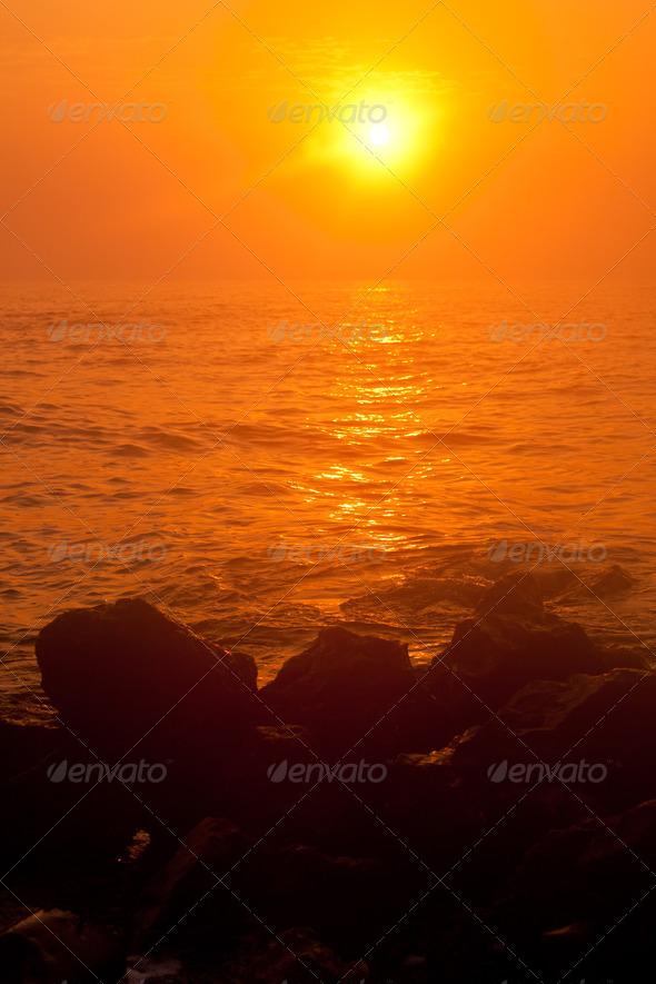sunrise through fog - Stock Photo - Images