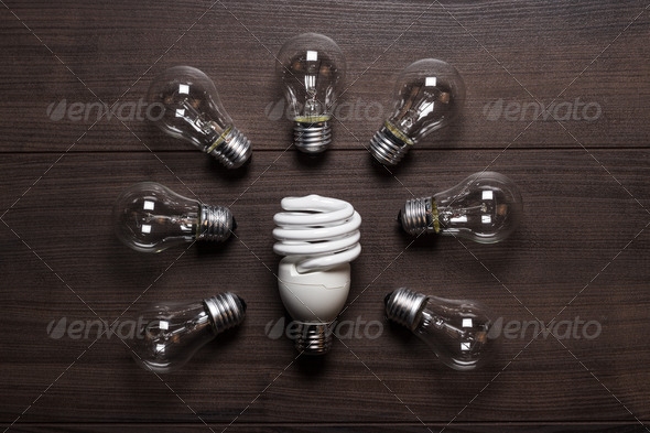 Energy Saving Lamp And Glow Lamps Concept - Stock Photo - Images