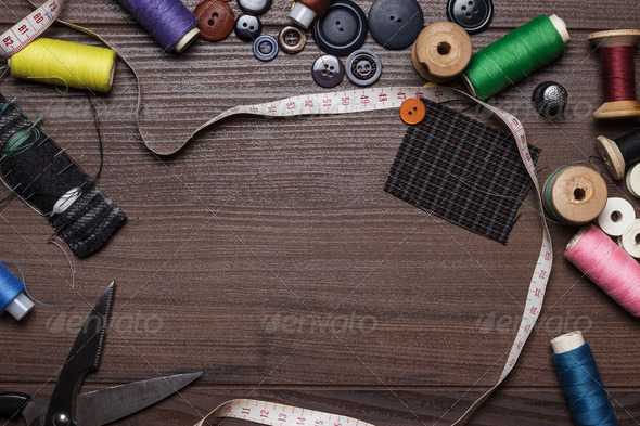 Threads Buttons And Needles Over Brown Wooden Table - Stock Photo - Images