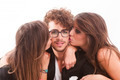 Two young attractive women kissing man - PhotoDune Item for Sale