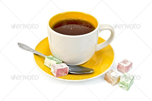 Tea in yellow cup with lokum - Stock Photo - Images