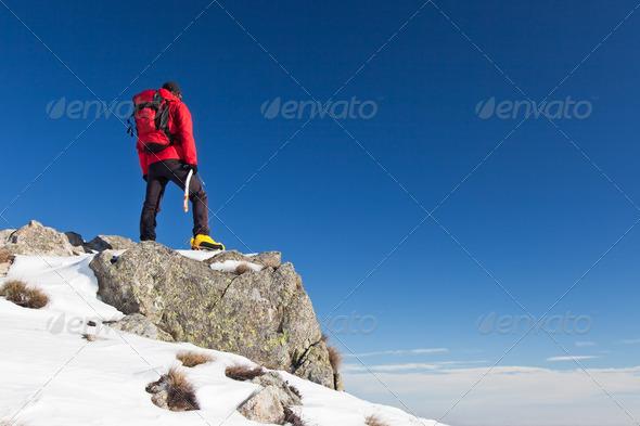 Trekker observes the horizon - Stock Photo - Images