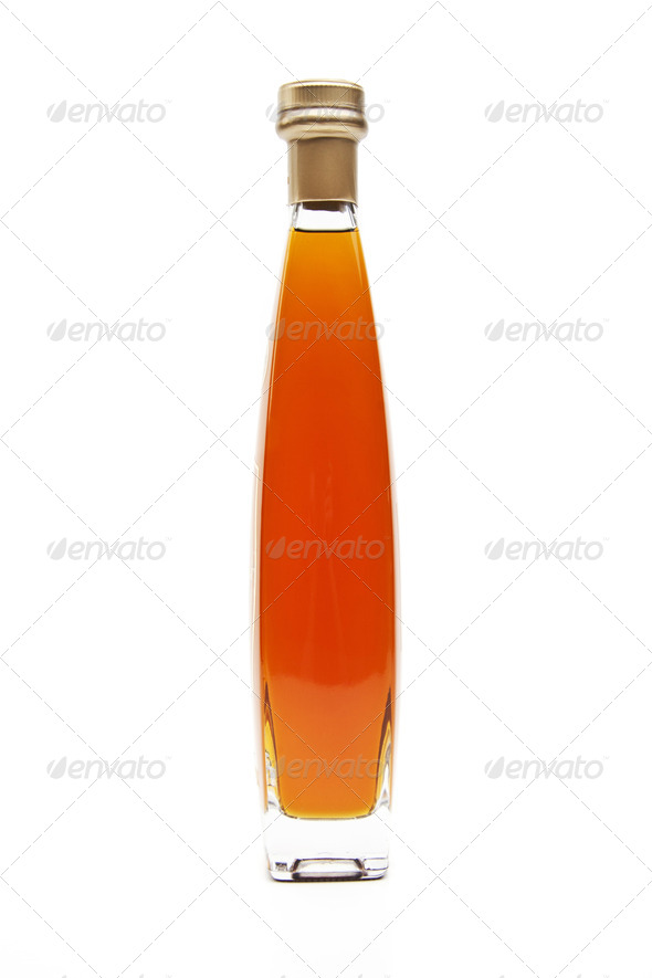 Alcohol cognac in a closed bottle on white background - Stock Photo - Images